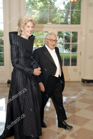 Henry Kissinger and Mrs Nancy Kissinger arrive at the White House for the State Dinner in honor of Queen Elizabeth II  and Prince Philip Duke of Edinburgh hosted by President Bush and the First Lady the White House.