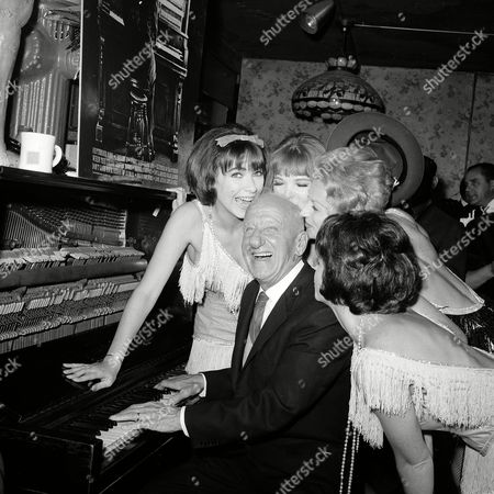 Durante Jimmy Durante is greeted by performers at the Gaslight Club where he celebrates his 50 years in show business in New York City