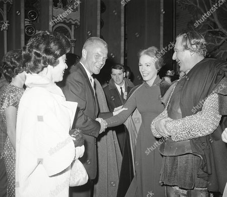 "Stock Image of Astronaut. John Glenn and his wife Annie shake hands with Julie Andrews as actor Robert Coote stands at right at the Majestic Theater in New York, . The Glenns saw the Broadway show ""Camelot"". Miss Andrews, who was on vacation, returned to the show when she learned that astronaut John Glenn was to be in the audience"
