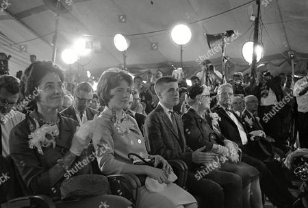 Stock Picture of Family of astronaut John Glenn, Jr., sits in the front row during his news conference at Cape Canaveral, Fla., . Left to right are Glenn's wife Annie, daughter Lyn and son David, parents John Herschel and Teresa Glenn, and Dr. H. W. Castor and Margaret Castor, parents of the astronaut's wife