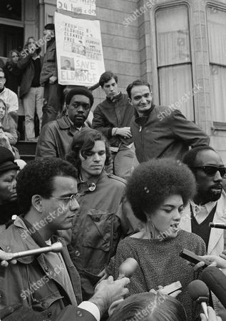 """Kathleen Cleaver Kathleen Cleaver, wife of the Black Panther minister of information Eldridge Cleaver, talks with newsmen on the steps of their home in San Francisco, . She said her husband should resist return to prison """"by any means necessary."""" Her statement came a few hours after Justice Thurgood Marshall in Washington turned aside the 33-year-old militant's claim his parole from a 13-year-old term on an assault conviction was revoked because of his political beliefs. Cleaver was not present at the news conference and his wife said she didn't know where he was"""