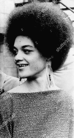 """Kathleen Cleaver, wife of the Black Panther parolee, is shown at a news conference here . She said her husband, Eldridge, should resist return to prison """"by any means necessary"""", and that if officers came for him with guns, """"he should use a gun to defend himself"""
