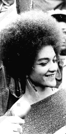 """Kathleen Cleaver, wife of the Black Panther parolee, is shown at a news conference here, . She said her husband, Eldridge, should resist return to prison """"by any means necessary"""", and that if officers came for him with guns, """"he should use a gun to defend himself"""