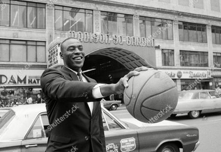 Cazzie Russell, All-America from the University of Michigan and 1965 Player of the Year holds basketball in front of New York's Madison Square Garden, . Earlier in the day, announcement was made that he and the Knicks had come to terms for the following season. The price was reported to be in excess of $200,000 spread over a long-term contract, not yet signed