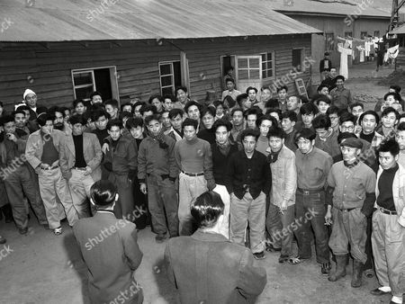 Some 900 Japanese fishermen, long interned at a Pusan detention camp in South Korea received the word, that an agreement had been reached with Japan on new year?s eve for their release and that would soon be going home. The fishermen, some in captivity for four years, had been aboard Japanese fishing boats seized for operating inside the ?Rhee line? which extends the South Korean territorial waters up to 60 miles from shore. The dramatic moment at the camp came as Capt. Park Hae Chin of the Kyongsang Namdo police bureau assembled the fishermen outside their barracks and read the announcement in Pusan on . The fishermen at first could not believe the news and then later rejoiced with joy. Capt. Park Hae Chin (right foreground, back to camera) makes the announcement to the Japanese fishermen