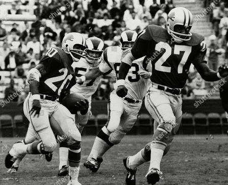 Left half Lem Barney of Detroit Lions is one his way to a touchdown after receiving the opening kickoff in their game with Los Angeles Rams at Los Angeles Coliseum on . Bobby Thompson of Lions runs interference (27) Rams shown are Doug Woodlief (57) and Joe Carollo (63