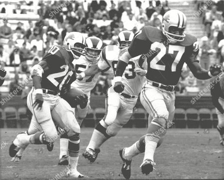 LIONS RAMS BARNEY Left Halfback, Lem Barney (20) of the Detroit Lions is on his way to a touchdown after receiving the opening kickoff in their game with the Los Angeles Rams at Los Angeles Coliseum, . Detroit's Bobby Thompson, #27, runs interference. The Rams shown are Doug Woodlief, #57, and Joe Carollo, #62