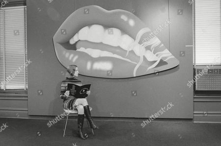 """This huge oil Painting by Tom Wesselman titled """"Mouth"""" is shown at the """"Homage to Marilyn Monroe"""" exhibit at the Sydney Janis Galleries in New York on . At left is Sandra Hunt, an employee of the galleries"""