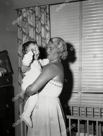Mary Ann Marciano, Barbara Masciano Baby Mary Ann Marciano, aged 1 ½ year, yawns widely as her mother, Barbara, prepares to put her to bed in Hotel Belmont-Plaza, New York City . Mary Ann, just can't be bothered about the all-important fact that her daddy, heavyweight champion, Rocky Marciano is putting his title on the line in a bout with challenger Ezzard Charles, in Yankee Stadium, New York City on June 17, but that's why her Mom brought her to the Big City