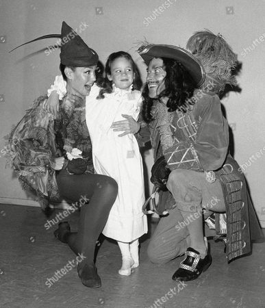 """Kathy Crosby, Mary Frances Crosby, Michael Evans Mary Frances Crosby, 6, center, will play one of the children in the play """"Peter Pan"""" at the Hyatt House Theater in Burlingame, California opening on . Peter Pan, left, will be played by her mother, Kathy, better known as Mrs. Bing Crosby. At right is Michael Evans who plays Captain Hook"""