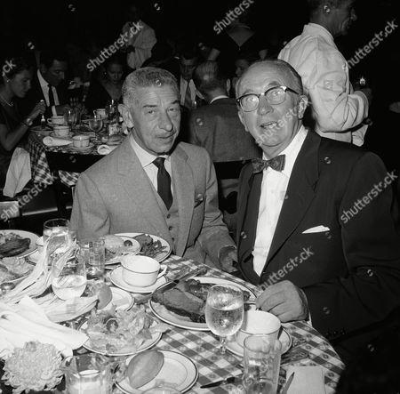 Restaurateur Mike Romanoff aka Harry Gerguson with actor Walter Brennan on