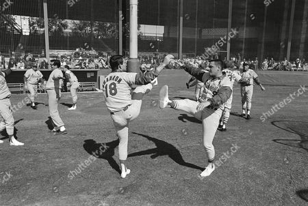 Mike Shannon, Roger Maris, Dick Sisler St. Louis Cardinals Mike Shannon, left and Roger Maris trip the light fantastic during calisthenics drills at their first day of spring training in St. Petersburg, Florida on . In background at right is Coach Dick Sisler