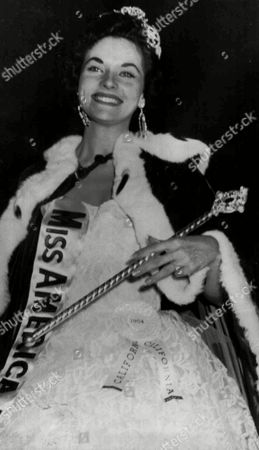 Stock Image of LEE ANN MERIWETHER Miss California, Lee Ann Meriwether of San Francisco smiles after being named Miss America of 1955 at Atlantic City, N.J. Sept.11, 1954. She carries the scepter and wears the robe of Miss America