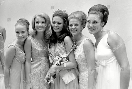 George Johnson Turner McClamroch Phyllis George, of Texas, center, poses with other contestents after she is crowned Miss America 1971 at the annual Miss America Pageant in Atlantic City, N.J., on . From left are, Karen Johnson, Miss Maine, second runner-up; Claudia Turner, South Carolina, first runner-up; Miss America; Christine McClamroch, Mississippi, third runner-up; and Margaret Walker, Pennsylvania, fourth runner-up
