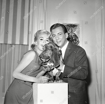 "Sandra Dee, Bobby Darin Hollywood's Sandra Dee and Bobby Darin pose with what Universal Studio says is the nation's champion candy-eating dog on . She is Polly, a bassett-type chosen from among more than a hundred sweet-toothed dogs co-star with Miss Dee and Darin in the movie ""If a Man Answers."" Polly's part calls for her to eat bowls of assorted candies. She likes peppermint best. Her owner is Barbara Couchman, 12"