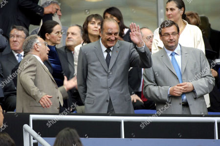 French president Jacques Chirac (C) waves to the crowd prior to the final match between Marseille vs Sochaux. French Football Federation president Jean-Pierre Escalette (L) and Jean-Francois Lamour (R)
