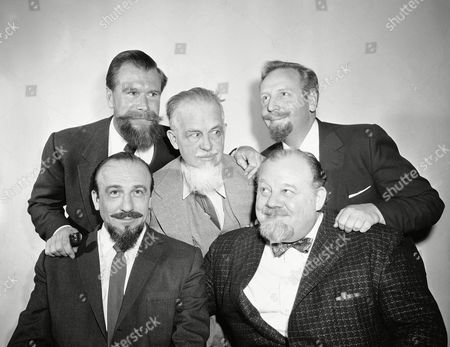 Five bearded men get together at the Sheraton-Astor in New York, . From left to right, front: Mitch Miller and Burl Ives. Left to right, rear: Commander Edward Whitehead, Rex Stoat and Skitch Henderson