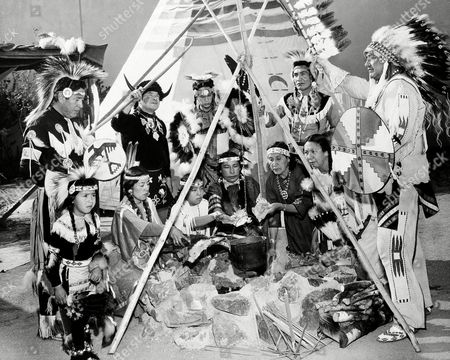 """Jim Owens Jim Owens, right, an Assiniboine Indian chief and manager of an Indian show at the Seattle World's Fair, poses on . With Indians in his show boiling some old moccasins to dramatize their need for food. Their show at the fair Indian Village was closed yesterday because of poor attendance and other problems. Owens said some of the Indians have not eaten for two days and are unable to pay their rent """"They (the village management) owe us about $3,500,"""" said the chief. """"We are on the warpath"""