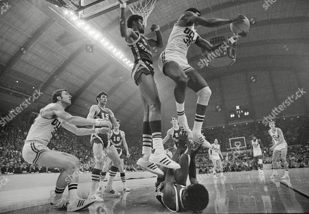 Sidney Wicks, Chip Dublin, Artis Gilmore UCLA's Sidney Wicks (35) comes down on Jacksonville's Chip Dublin who fell while aiding an attempted basket by Artis Gilmore (53) during first period play in the NCAA championship finals at College Park, Md