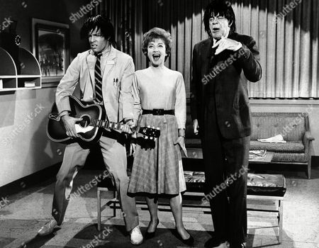 "Stock Image of They call it the Beatle bug. Actors Richard Chamberlain, left, Raymond Massey and guest star Anne Baxter all appear to be infected as they give an imitation of the mop-haired British pop group on the set of television's ""Dr. Kildare"" in Hollywood, Los Angeles, California, on . The take-off will not be shown on the network but will be included in the annual gag film which the Kildare cast and crew put together for laughs"