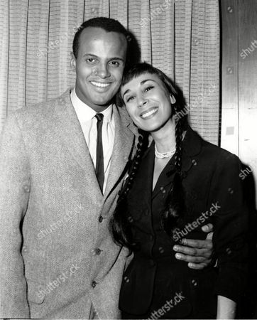 Belafonte Robinson Singer Harry Belafonte and his bride, dancer Julie Robinson, pose in his dressing room at a night club in Brooklyn, N.Y. on . The newlyweds announced they were secretely married at Tecate, Mexico on March 8