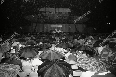 Jazz fans huddle under umbrellas as heavy shower came during the Newport Jazz Festival concert in Newport, Rhode Island on . Featured at the time was Marilyn Maye, Jazz vocalist