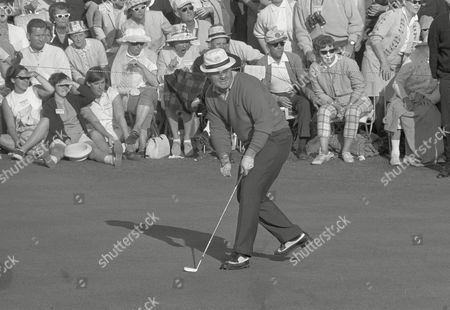Golfer Jack Nicklaus and a fan behind him react simultaneously as Nicklaus' 40 foot birdie putt on 18th green ends up within inches of the cup in final round of the Master Golf Tournament in Augusta, Ga. Nicklaus shot par on the hole and ended in a three way tie with Gay Brewer and Tommy Jacobs