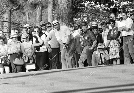 Jack Nicklaus chips on to the 10th green of Augusta, Ga Golf Club to go ahead in playoff Masters championship against Tommy Jacobs and Gay Brewer Jr. and stayed ahead to win the title for the third time. Jacobs bogied and Nicklaus pared the hole, to go one stroke in the lead at this stage