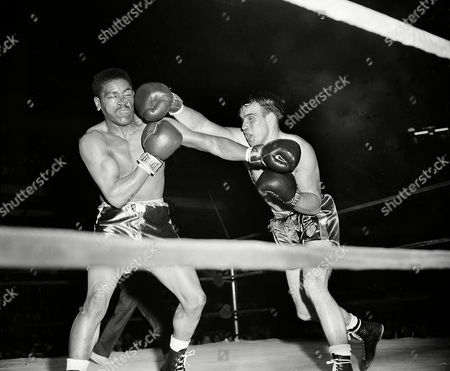 Norman Smith, Earl Raymond Norman Smith, right, of Emeryville, Calif., lands a right on the face of Earl Raymond of Philadelphia, Pa., during their 165-pound semifinal bout of the National AAU Boxing Championships at Boston Garden in Boston, Mass., . Smith outpointed Raymond to win the bout