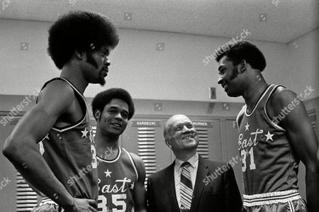 Stock Picture of Watchf Associated Press Sports College Basketball Men Ohio United States APHS55093 COLLEGE ALL STAR Three college All-Americans, Artis Gilmore, left, Jacksonville University, Austin Carr, Notre Dame, and Jim McDaniels, right, Western Kentucky, talk with coach A.C. Lonborg, before their East team face West in the College All Star basketball game in Dayton, Ohio on . Gilmore and McDanils have signed multi-million dollar contracts for the pros. Carr hasn't signed yet
