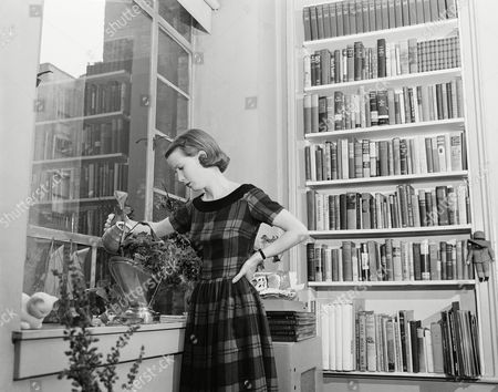 Harris Stage actress Julie Harris waters a plant in the living room of her New York City apartment in Jan. 1952