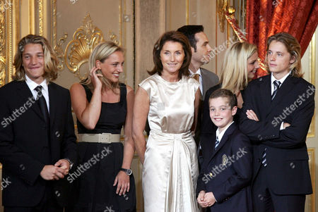 Cecilia Sarkozy, wife of new President Nicolas Sarkozy with her son Louis Sarkozy (3rd right), her daughters Judith Martin (2nd left) and Jeanne-Marie Martin (2nd right) and her stepsons Jean Sarkozy (left) and Pierre Sarkozy (right