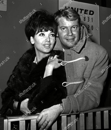 DONAHUE Suzanne Pleshette shows off her engagement ring as she poses with her husband-to-be, Troy Donahue in Los Angeles in this December 1963 photo. Donahue, a blond, blue-eyed teen heartthrob of the 1950s and '60s, died Sunday. He was 65. Donahue died at St. John's Hospital and Medical Center in Santa Monica after suffering a heart attack on Thursday, said family friend Bob Palmer. The actor played Sandra Dee's young lover in 1959's ''A Summer Place,'' a role that made him a teen matinee star.A family friend says Donahue had suffered a heart attack last week. Donahue was 65