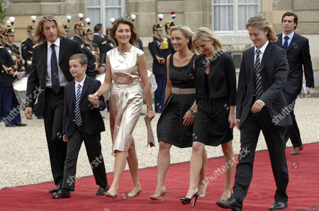 Cecilia Sarkozy (3rd left), wife of France's new President Nicolas Sarkozy, arrives with her son Louis Sarkozy (2nd left), her daughters Judith Martin (centre) and Jeanne-Marie Martin (2nd right), her stepsons Jean Sarkozy (left) and Pierre Sarkozy (right) for the handover ceremony at the Elysee Palace