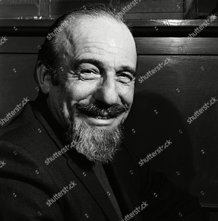 """Conductor Mitch Miller is seen at the Billy Rose Theater in New York. Miller, the goateed orchestra leader who asked Americans to """"Sing Along With Mitch"""" on television and records, has died at age 99. His daughter said Miller died in New York City after a short illness"""