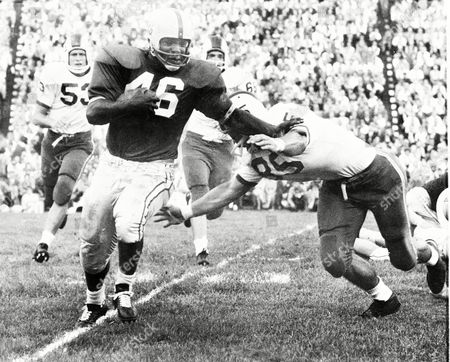 Bob Ferguson, Claude Moorman, Ted Royall, Joe Wuchina Ohio State's Bob Ferguson (46) stiff arms Duke's Claude Moorman (85) to pick up five yards and an OSU first down in the first quarter, in Columbus, Ohio. Duke's Ted Royall (53) and Joe Wuchina (66) chase him in vain