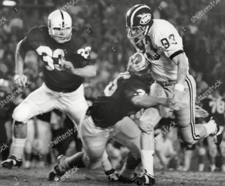 Tom Shryock (93) of Missouri runs with the completed pass from quarterback Terry McMillan in the first period of game in Miami, Florida. Making the stop for Penn State are Dennis Onkotz (35) and Jack Ham (33