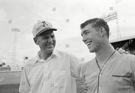 Bear Bryant, Paul Bryant, Steve Sloan Alabama coach Bear Bryant talks with his star quarterback Steve Sloan, right, after practice in Miami for the Orange Bowl game New Years' night against Nebraska, . Both denied stories swirling about the pair; that Bryant had suffered a stroke, and that Sloan had signed a pro football contract