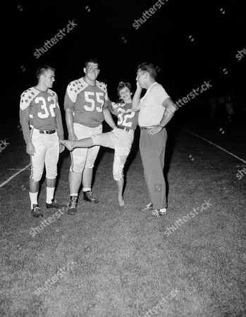 Stock Image of Otto Graham When the All Star player showed up for workout wearing the new uniforms they'll gear against the Baltimore Colts on Friday night, here seemed to be a mix-up as two No. 32's appeared on the field in Chicago on . But Coach Otto Graham (right) really isn't perplexed, as one of the uniforms is worn by the game's Princess, Judie K. Klukos of Grand Haven, Michigan, who is a student at Western Michigan College. Players are Don, Brown (32) of Houston Iowa and Mac Lewis (55) of Iowa