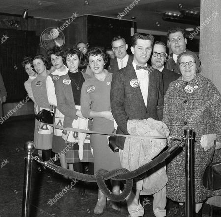 "Fans of television star Jack Paar, some wearing ""Come Back Jack"" buttons, stand in line to attend taping of show at NBC Studios in the RCA Building, New York City, . Announcer Hugh Downs is replacing Paar, who walked off the show on February 11, in a dispute over censorship. At right is Dorothy Miller, a regular member of the Paar audience"
