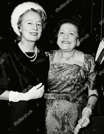 """Gossip columnist Louella Parsons, right, is shown with actress Irene Dunne, at a party at the Four Seasons in New York, in honor of the publication of Ms. Parson's """"Memoirs"""" in McCall's magazine, Oct. 1961"""