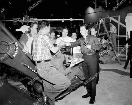 Stock Photo of Pat Boone Singer Pat Boone passes out cigars to camera crew on set of his television show in New York City, after learning his wife, Shirley, gave birth to 7 pound 12 ounce daughter in Hackensack, New Jersey hospital. The newcomer has three sisters, Cheryl Lynn, 3 ½ Linda Lee, 2 ½, and Deborah Ann, 1