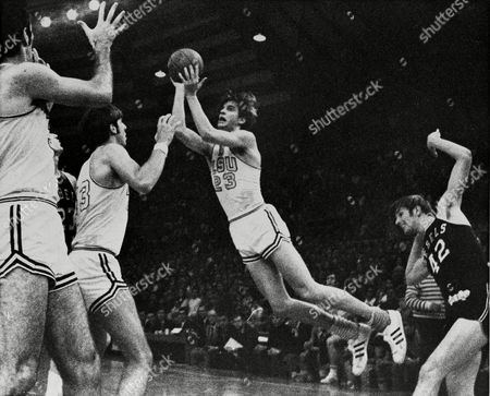"Pete Maravich, Tom Butler, Danny Hester, Bill Newton Louisiana State Pete ""Pistol"" Maravich (23) flies through the air during record breaking performance in Baton Rouge, Louisiana, to become college basketball's leading scorer of all-time. At right is University of Mississippi's Tom Butler (42) and at left are LSU's Danny Hester (35) and Bill Newton (43"