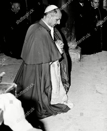 Paul VI, Giovanni Battista Enrico Antonio Maria Montini Pope Paul VI kneels in prayer on the floor of the hall where Jesus is believed to have held the Last Supper, atop Mount Zion in the Israeli section of the Holy Land, Jerusalem