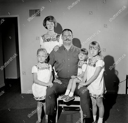 Ben Davidson, Kathy Davidson, Dana Davidson, Vicky Davidson, Janella Davidson Defensive Lineman Ben Davidson, of the Oakland Raiders, sports a handlebar mustache as he poses with his family in an 1890s-type Father's Day portrait at their home in Hayward, Calif., . From left are: Dana, 5; wife Kathy; Vicky, 3; and Janella, 6. Big Ben's girls are all wearing matching flower bordered dresses purchased on a recent vacation to Mexico