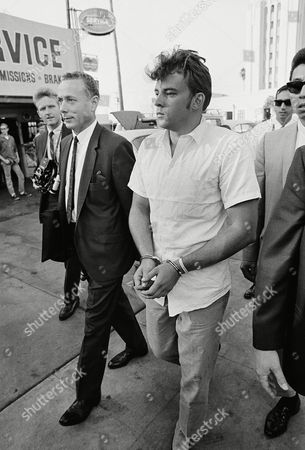 Paul Robert Ferguson, 22, in handcuffs, is escorted by police from jail to a court appearance in Hollywood, . Ferguson and his 17-year-old brother Thomas Scott Ferguson, have been booked on suspicion of murder in the bludgeon death of silent screen actor Ramon Novarro
