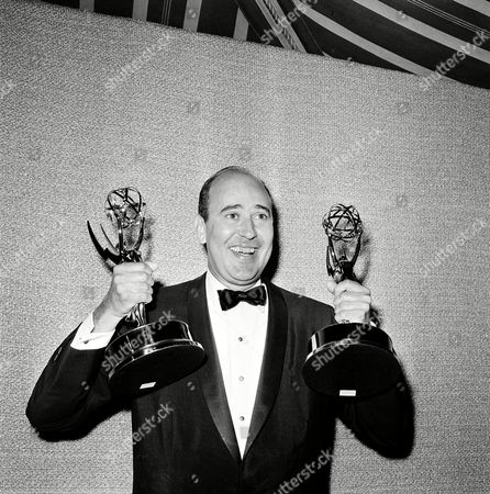 """Carl Reiner shows off two Emmy statuettes presented to him as best comedy writer for the """"Dick Van Dyke Show,"""" during the annual Emmy Awards presentation in Hollywood, Calif., on"""