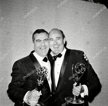 """Writer Carl Reiner, right, and director John Rich pose with the Emmy awards they won for their work on the """"Dick Van Dyke Show,"""" during the annual Emmy Awards presentation in Hollywood, Calif., on . Reiner was awarded best comedy writer and Rich was named best director"""