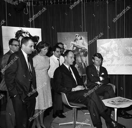 Sen. Robert Kennedy, D-N.Y., narrated the filmed story of his recent climb to summit of Mount Kennedy, at studios of American Broadcasting Company in Washington on . With him is James Whittaker of Seattle, who was one of the climbers with Kennedy. Kennedy and Whittaker listen to the playback of tape with Mrs. Ethel Kennedy standing in rear