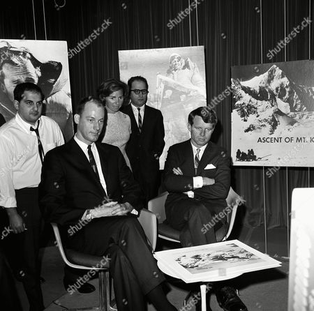 Sen. Robert Kennedy, D-N.Y., narrated the filmed story of his recent climb to summit of Mount Kennedy, at studios of American Broadcasting Company in Washington on . With him is James Whittaker of Seattle, who was one of the climbers with Kennedy. Mrs. Ethel Kennedy stands behind her husband